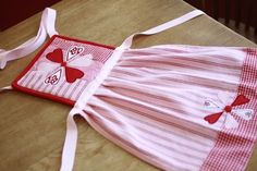Child's sized apron using a potholder and towel.