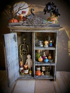 Just in time for Halloween! This spooky witches cabinet is filled with potions, pumpkins, bottles, skeletons and all sorts of creepy things (all accessories are glued in place and the tiny gold box on the bottom shelf opens;) This 1:12 scale piece of furniture is Handmade,