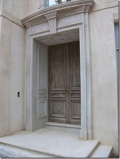 Note how the side walls of the limestone door surround are carved to emulate the lines of the antique door.