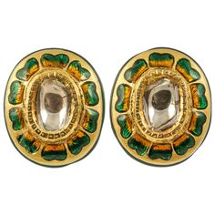 Indian Enamelled Earrings. 19th Century Indian enamelled details earrings set in 18ct Gold with central old cut Diamond