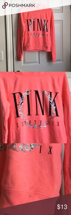 VS Pink Sequin Hoodie with Pockets Adorable hoodie. The color is. Neon coral. A pocket on each side. Comfy and warm. Has a tiny stain on the bottom front from makeup. You might be able to get it out with stain remover but I haven't tried. PINK Victoria's Secret Tops Sweatshirts & Hoodies
