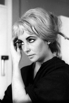"Liz Taylor... ""oh what the hell..., go ahead, I guess I can just redefine blonde bombshell too."""
