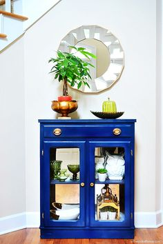 Spray painting furniture. Bold royal blue? Love how it looks with the gold hardware.