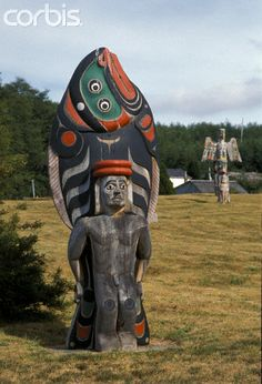 Kwakwaka'wakw wooden totem pole of a halibut and man located in the Nimpkish Burial Grounds at Alert Bay on Cormorant Island, British Columbia.  