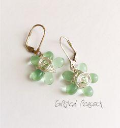Wire wrapped flower earrings by TwistedPeacock on Etsy https://www.etsy.com/listing/157006189/beaded-earrings-silver-earrings-flower