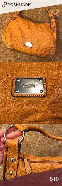 """Nine West Handbag Orange/tan colored Nine West Handbag. Zip top closure, with short, single handle strap. Matte silver hardware. Inside zip pocket, faux leather. Exterior has no signs of wear, other than a little """"wrinkly"""". Inside fabric has slight marks as seen in the photo. Smoke free home Nine West Bags Hobos"""