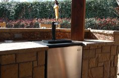 Beer aficionados, we can make you happy, too! This beer keg was easily built into the outdoor kitchen design. By Outdoor Signature in Argyle, TX