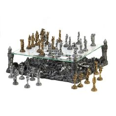 "Battleground Chess Set ......Prepare for battle and defend your kingdom with this intricate and breathtaking medieval-inspired chess set! The glass game board is held aloft by four towers of the castle, revealing the remains of previous clashes below. Warring royalty and their brave knights are in full battle regalia, complete with swords and shields, in either silver-tone or bronze-tone.  Tallest game piece is 3"" high; Smallest game piece is 2 3/8"" high."