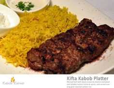 KIFTA KABOB PLATTER  Minced beef with diced onion & cilantro marinated with Middle Eastern herbs & spices, and servced over long grain basmati yellow rice