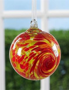 Red & Yellow multi-hued Ball of Friendship Tree Ornament would be a great gift for a friend. Glass is used for this ornament to represent the fragile nature of a friendship. #scottsmarketplace