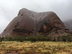 Australia's most iconic red rock, also known as Ayers Rock at Uluru-Kata Tjuta National Pa...