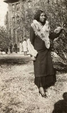 This is an old photograph of a young African American lady posing for the camera on a Winter's day. There is nothing to identify this lady or when or where this photograph was taken. My guess is that this was sometime during the late 1920's or early 1930's.