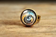 Hey, I found this really awesome Etsy listing at https://www.etsy.com/listing/156822623/astronomical-steampunk-ring-adjustable