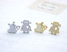 Little robot metal stud earrings. For all your robot needs. These little guys are made Rhodium Plated findings and 14k matte gold Plated findings. so Geek Chic!! This is a pair of adorable robot earri