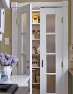 love these doors for a pantry or linen closet (or kitchen cupboards)