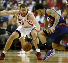 Houston Rockets forward Donatas Motiejunas (20) and Phoenix Suns guard Gerald Green (14) reach for a loose ball during the second half of an NBA basketball game at Toyota Center, Saturday, Dec. 6, 2014, in Houston. ( Karen Warren / Houston Chronicle  )