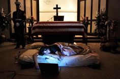 "The night before the burial of her husband's (2nd Lt. James Cathey) body, Katherine Cathey refused to leave the casket, asking to sleep next to his body for the last time. The Marines made a bed for her, tucking in the sheets below the flag. Before she fell asleep, she opened her laptop computer and played songs that reminded her of ""Cat."" This photographic series won the 2006 Pulitzer Prize in Feature Photography."