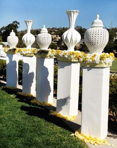 Our Kamal Vase and Ceramic Filigree Jar create a beautiful backdrop to this outdoor wedding.  Photo: blog.hwtm.com