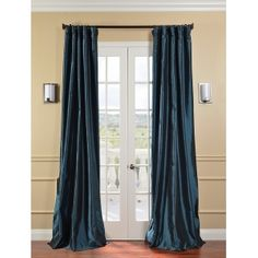 like these curtains if the color is as it appears on my monitor:  Color: Gleaming teal blueDefined by a unique sheen and fine weave, ...