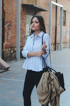 #Spring #outfit perfect to #work wearing striped peplum shirt, jeans, #trench and #heels.