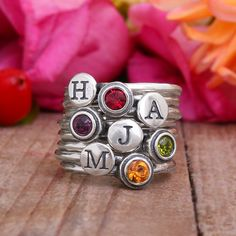 Stackable Family Ring includes 4 Initial Stack Rings and 4 Birthstone Rings in Sterling Silver.  Total of 8 Stacking Rings in set.