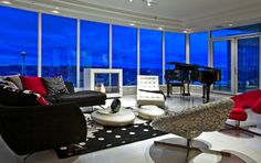 "Escala: The Great Room with Piano    "". . .The far wall is glass and leads onto a balcony that Overlooks Seattle.  To the right is an imposing U-Shaped sofa.  It faces a state-of-the-art stainless steel . . . modern fireplace."" (Book 1, Page 83) #FiftyShades @50ShadesSource www.facebook.com/FiftyShadesSource"