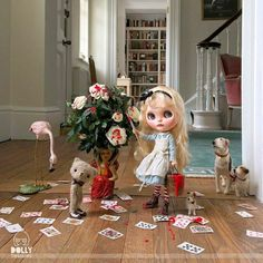 Dolly Treasures painting the roses red!