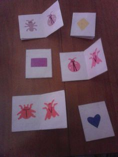 Mini Books; index cards, bug/shape die cuts, glue, contact paper. Excellent for small muscle development, color, shape, bug recognition.