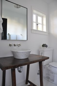 Hollywood - White bathroom with marble sink and rustic table