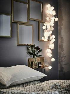 décorer son appartement, mur gris anthracire, guirlande lumineuse, chambre a coucher grise