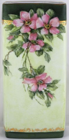 Hand Painted Bavarian Porcelain Vase with Roses by Margaret Surber (American 1913-2001) on a pale green background, she has painted gorgeous pink wild roses with leaves