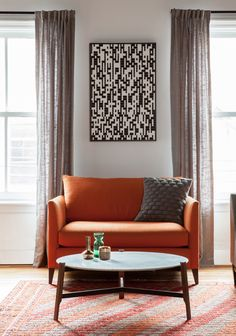 Orange settee (Crate&Barrel), marble coffee table (BluDot), vintage orange Kilim (Sophie's Bazaar), custom morse artwork. Styled with CB2 and H&M Home accessories.