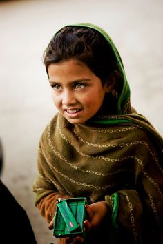 Stunning afghan girl selling candies in the street. Photo by Schmidt Photography