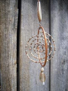 Goddess Spiral - Brighid - Imbolc - by RadicalFringeDweller on madeitGoddess Spiral - Brighid -And the site it's on is pretty cool!Goddess Spiral - Wire, beads and a few other supplies and could make easily…Neat shape for a windchime/ suncatcher ty Wire Crafts, Bead Crafts, Wire Jewelry, Jewelery, Deco Nature, Wiccan Crafts, Bijoux Diy, Sun Catcher, Beads And Wire