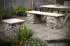 More Easy Garden Projects with Stones | The Garden Glove -- could make a bench or two with left over rocks when the rock wall is done. #WoodBenchIdeas