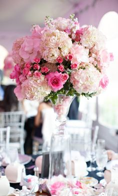 Hydrangeas and pink roses tall wedding centerpiece