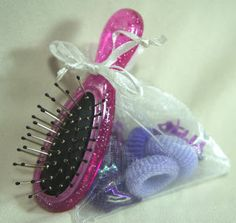 Karen Mom of Three's Craft Blog: Stocking Stuffer ideas Day #5 - Great idea for a goody bag, and all (but the brush) can be found at Dollar Tree