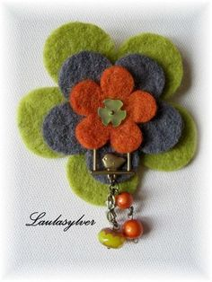 These larger felt flowers cut from our thick wool felt. Works wonderfully with our other felt shapes in many applications. These felt flowers team well with the smaller felt flower and felt petals to make br Fabric Brooch, Felt Brooch, Textile Jewelry, Fabric Jewelry, Felt Flowers, Fabric Flowers, Diy Flowers, Felt Crafts Patterns, Felted Wool Crafts