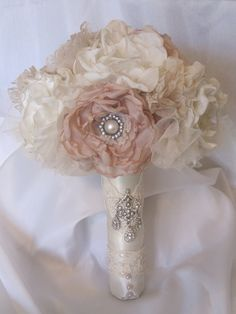 Wedding Bouquet Vintage Inspired Fabric Flower Brooch Bouquet in Ivory and Champagne with Pearls, Rhinestones and Lace. $225.00, via Etsy.