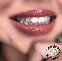 Tooth gems at Halo Tattoo Collective in Long Beach