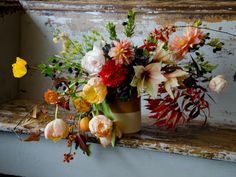 Thanksgiving arrangement in vitrified studio crock