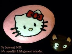A bit more detail on the rocks I made as a gift for the Sweet Kitty owner. Hello Kitty and Chococat painted rocks. By Julesong, 2014.