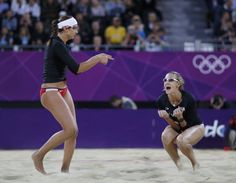 Misty May-Treanor and Kerri Walsh of the U.S. celebrate a point against the Netherlands during their women's round of 16 beach volleyball match at the London 2012 Olympic Games