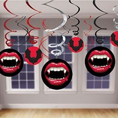Who wouldnt want our Transylvania inspired vampire #Halloween Decor. Our Halloween Decorations feature a pack of 12 foil swirl decorations. 6 of the swirls have attached cut outs of flying bats and bloody vampire fangs. Our Scary Halloween Decorations vary in size, 3 swirls have 7 inch cutouts attached while the other 3 have 5 inch cutouts attached. There are also 6 plain foil swirls included which come in sliver, red and black.