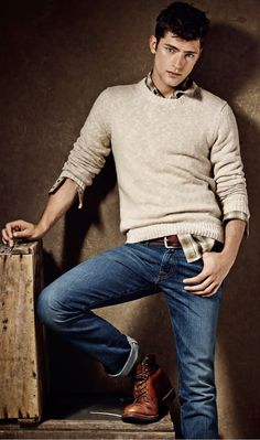 Sean O'Pry's style for men: neutral pullover, plaid shirt, denim and boots
