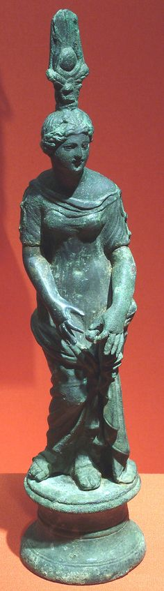 1st–2nd C. Isis-Aphrodite clasping a garment rolled about her hips. Roman-Egypt. This 10 1/4 in. bronze statuette may be Empress Faustina Minor, wife of Marcus Aurelius (AD 161-180) in this role, thus attributing to Faustina a role as guarantor of the grain shipments from Egypt to Rome at a time of revolt in part of the Empire.