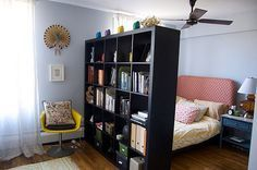 Divide the studio in half (gallery vs. studio) by using two large bookcases.