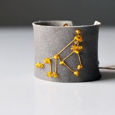 Free Tutorial: How to make an embroidered zodiac leather cuff. Via Tuts+