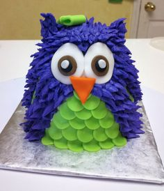 Owl cake for first birthday in purple and green