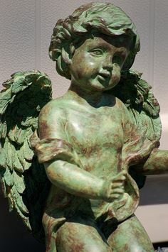 Li'l green cherub by racineur, via Flickr